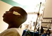 REHAB--02/14/07-13 year old Isaac Kolade of Hamilton sits in his room at SickKids hospital. Isaac su