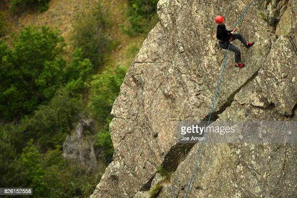 15 year old Jacob Leibrandt from Michigan repelling for the first time to his uncle Dave Leibrandt of Superior on Lookout Mountain Crag August 3 2017...