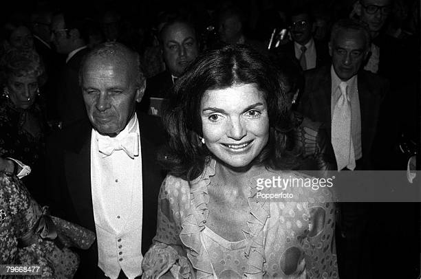 43 year old Jaqueline Onassis the former Jackie Kennedy pictured smiling brightly as she arrives at New York's Metropolitan Opera House 4th June 1973