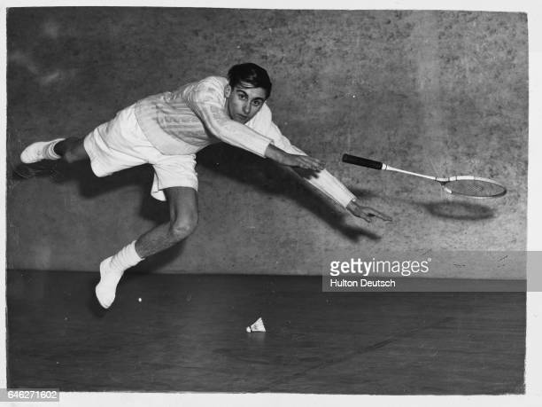 17 year old Jim Graham of Kendal loses his racket as he jumps for a shot during the All England junior badminton championship at Wimbledon