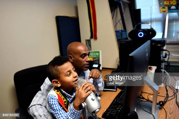8 year old Jonathan Endale recording messages with his father Endale Getahun the radio manager at KETO FM 939 Rocky Mountain Multicultural Community...