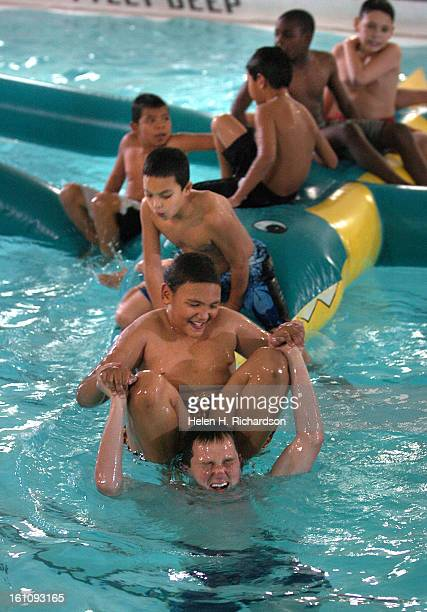 11 year old Kendrick Steusloff <cq> plays in the pool with his mentor Tyler Carner <cq> at the pool at the 20th Street Recreation Center at 1011 20th...