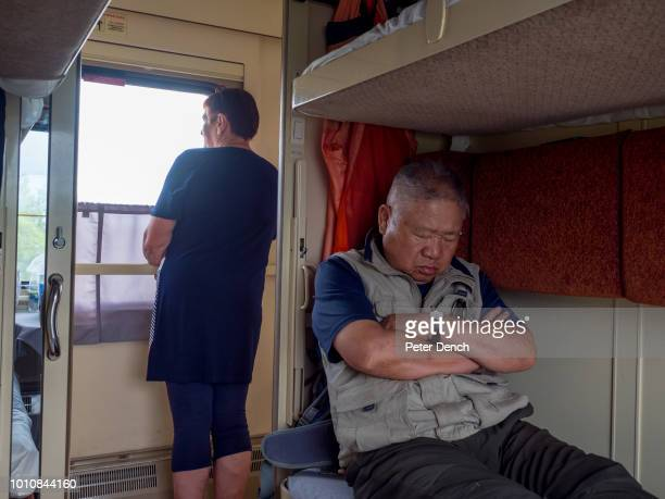 67 year old Korean engineer Chong asleep on his second class bunk The TransSiberian Railway from MoscowVladivostok spanning a length of 9289km is the...