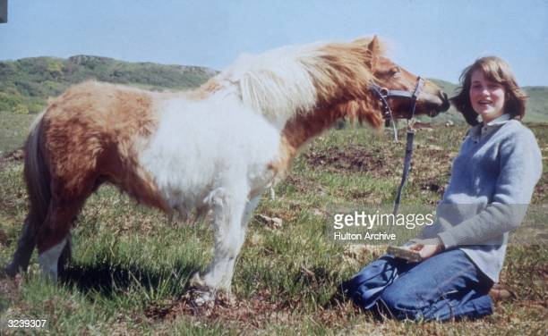 14 year old Lady Diana Spencer later the wife of Prince Charles being kissed by her pet pony 'Scuffle'