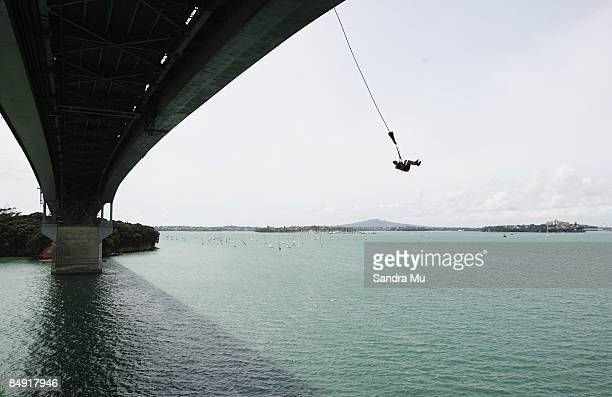 17 year old Levi Sherwood swings over the Auckland Harbour as the Crusty Demons bungee jump off Auckland Harbour Bridge February 19 2009 in Auckland...