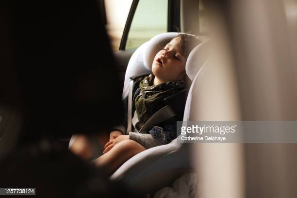a 3 year old little boy sleeping in a car - sleeping stock pictures, royalty-free photos & images