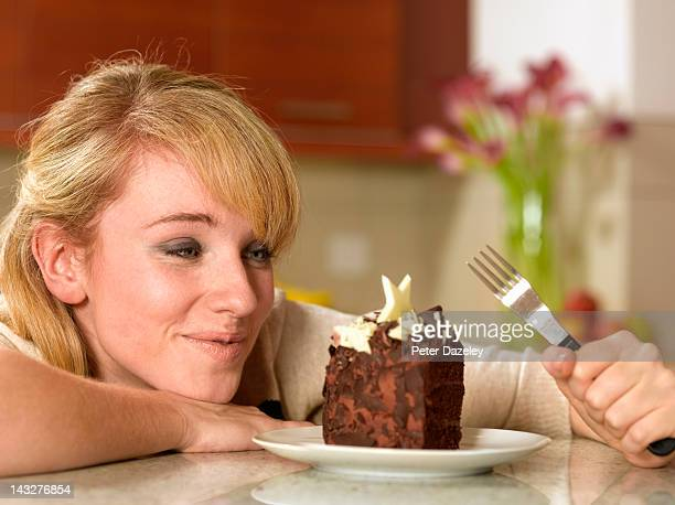 21 year old looking longingly at a cake