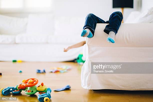 5 year old looking tired after playing with toys - messy stock pictures, royalty-free photos & images