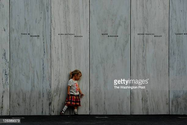 3 year old Lyra Nacke at the memorial wall during private time there for survivor families Her uncle Louis Nacke died on Flight 93 Thousands attended...