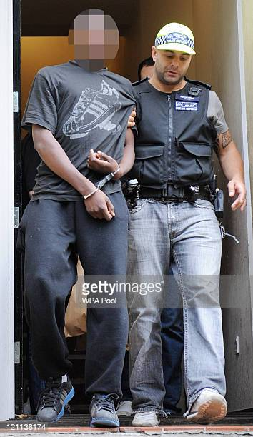 A 17 year old male suspect is arrested at a property on Villa Road Brixton for violent disorder in connection with recent rioting and looting in the...