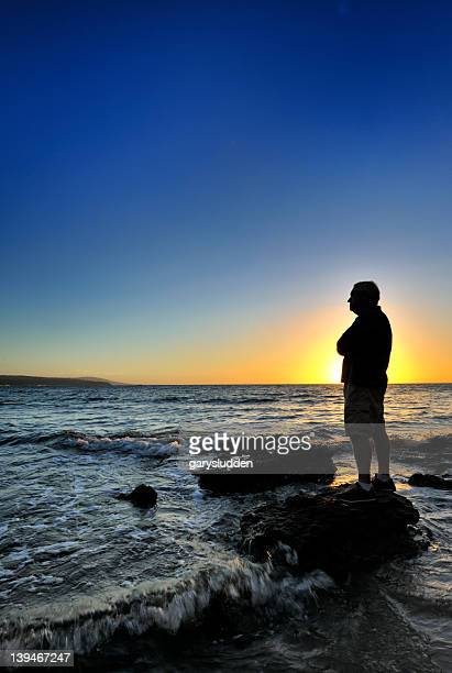 65 year old man alone on sea front