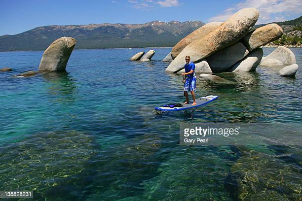 56 year old man on a stand up paddle board