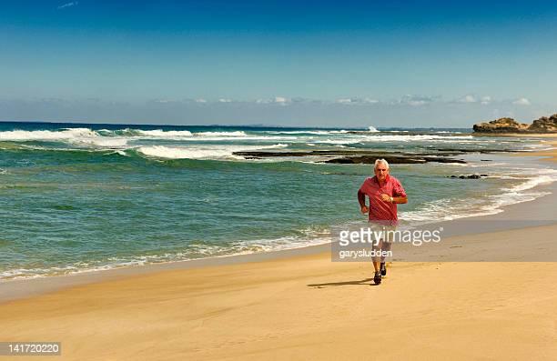 65 year old man running on the beach
