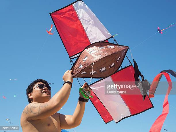 35-39 year old man trying to fly pirate ship kite