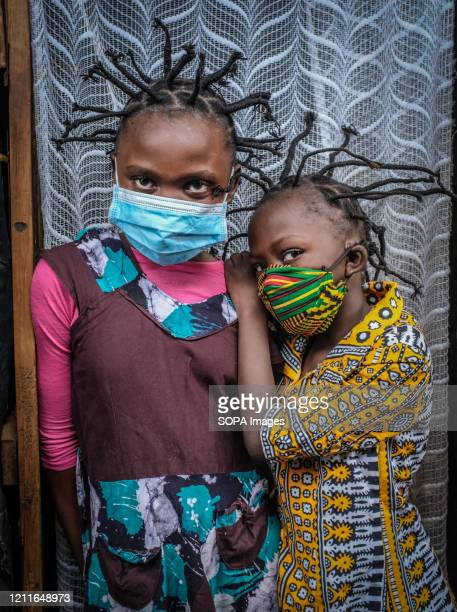 12 year old Martha Apisa and her close neighbour 8 year old Stacy Ayuma are seen using their hair style braids to create awareness and sensation...