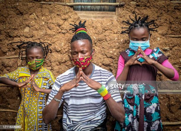 12 year old Martha Apisa and her close neighbour 8 year old Stacy Ayuma with an elder are seen using their hair style braids to create awareness and...