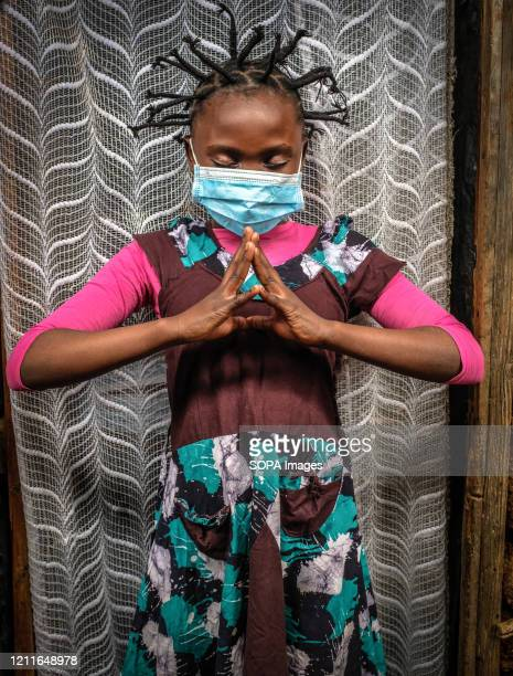 12 year old Martha Apisa is seen using her hair style braids to create awareness and sensation about the Corona Virus during the pandemic Daily life...