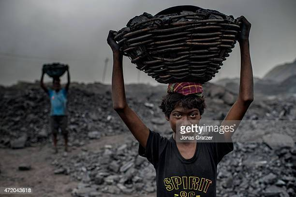 16 year old MD Kahn is a worker at the Jharia coal mineJharia in India's eastern Jharkand state is literally in flames This is due to the open cast...