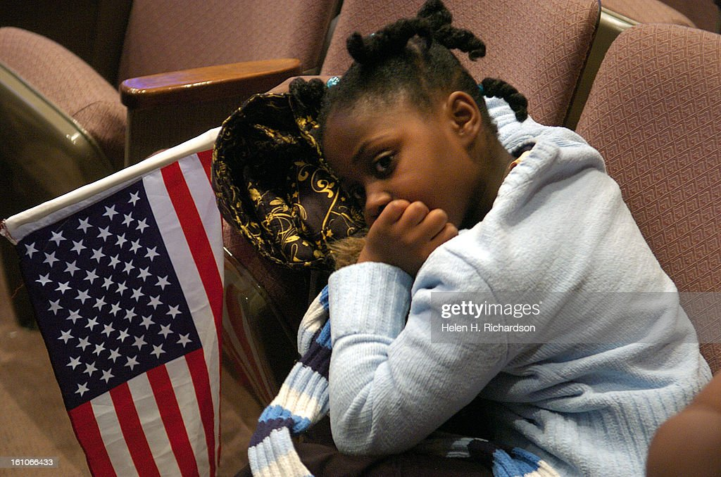 (HR) ABOVE: 6 year old MelYann Ichaka <cq> holds an American flag to show her appreciation for the LIttle Rock Nine during the gathering. The nine members of what is now called the Little Rock Nine came together for only the 5th time in 50 years at Congre : News Photo
