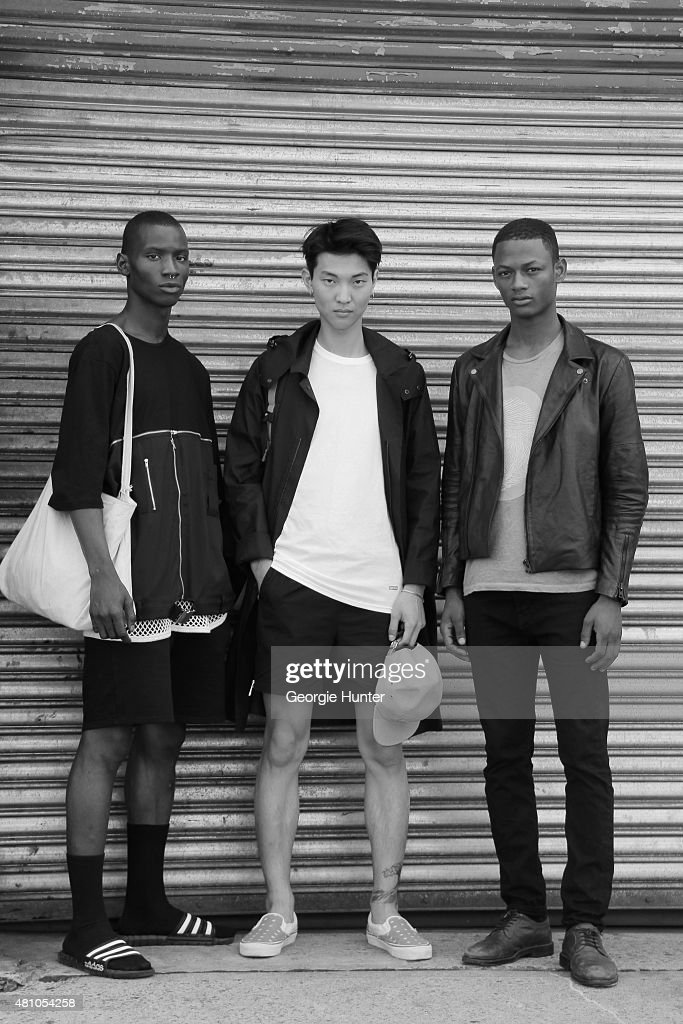 25 year old model Adonis Bosso from Ivory Coast, 21 year old model Jun Young from South Korea and 22 year old model Lucas Cristino from Brasil seen at Skylight Clarkson Sq, Adonis wears outfit by Hood By Air and Adidas shoes, Jun wears Lanvin coat, Supreme T-shirt and hat, Courgiem shorts and Vans with Gosha Rubchinskiy shoes and Lucas wears Levis jeans, Etro top, Blood Brother jacket and Aldo shoes during New York Fashion Week: Men's S/S 2016 on July 16, 2015 in New York City.
