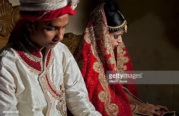 32 year old Mohammad Hasamur Rahman poses for photographs with his new bride 15 year old Nasoin Akhter August 20 2015 in Manikganj Bangladesh In June...
