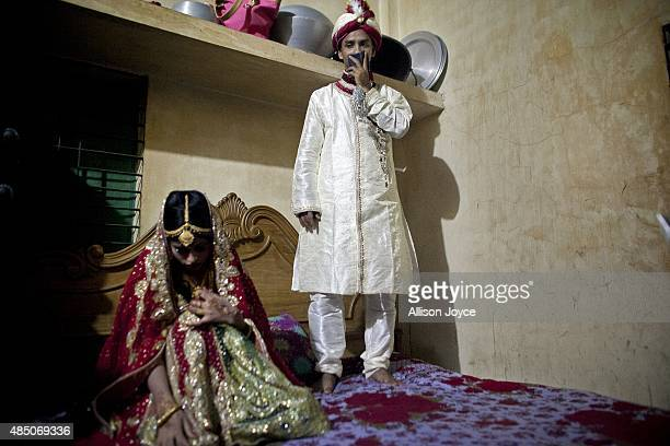 32 year old Mohammad Hasamur Rahman stands on a bed above his new bride 15 year old Nasoin Akhter August 20 2015 in Manikganj Bangladesh In June of...