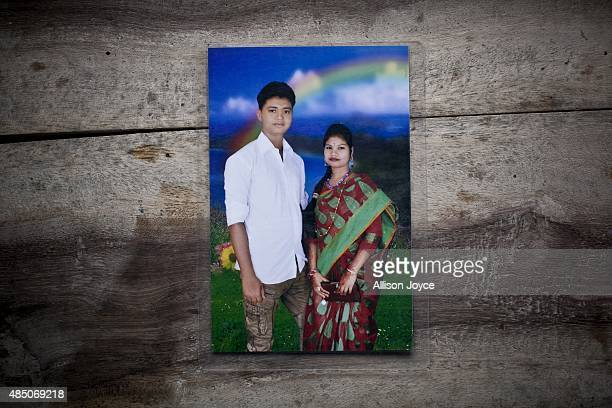 18 year old Mohammad Solaiman is seen in a photograph with his wife 14 year old Shima Akhter on August 19 2015 in Manikganj Bangladesh Last year when...