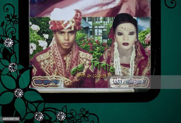 27 year old Mohammad Sujon Mia and his wife 14 year old Mousammat Akhi Akhter are pictured in their wedding photo August 19 2015 in Manikganj...