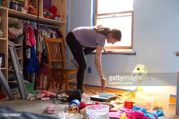 40 year old mom painting daughters room by herself - catherine ledner stock pictures, royalty-free photos & images
