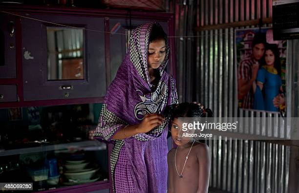 14 year old Mousammat Akhi Akhter does a relatives's hair in her home August 19 2015 in Manikganj Bangladesh Last year when she was only 13 Akhi got...
