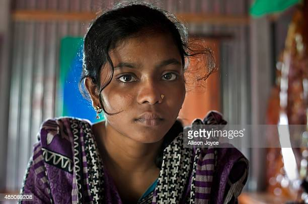 14 year old Mousammat Akhi Akhter is seen in her home August 19 2015 in Manikganj Bangladesh Last year when she was only 13 Akhi got married a 27...