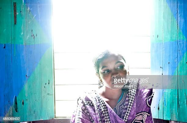 14 year old Mousammat Akhi Akhter poses in her home August 19 2015 in Manikganj Bangladesh Last year when she was only 13 Akhi got married a 27 year...