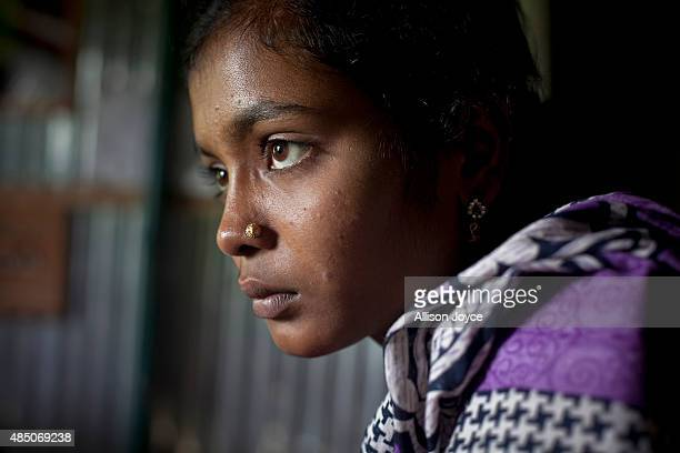 14 year old Mousammat Akhi Akhter sits in her home August 19 2015 in Manikganj Bangladesh Last year when she was only 13 Akhi got married a 27 year...