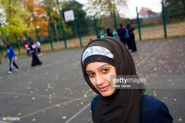 15 year old Muslim Mahnoor Chaudry at the Tuesday after school netball club at Villiers High School Mahnoor's father was born in the UK her mother...