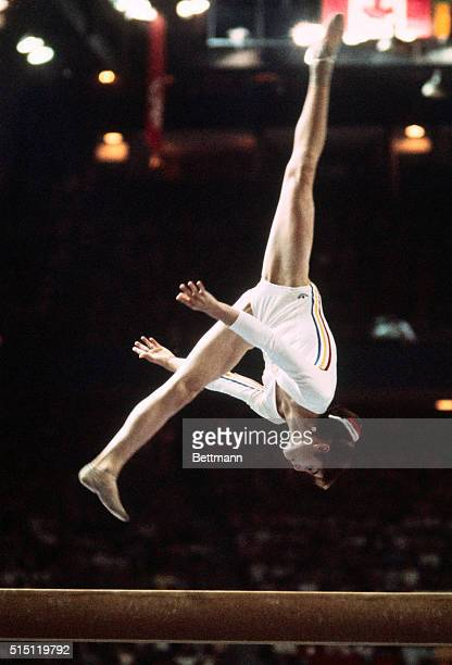 Year old Nadia Comaneci, the Romanian gymnast is shown leaping with one foot especially high in the air, during her floor routine at the 1976 Summer...