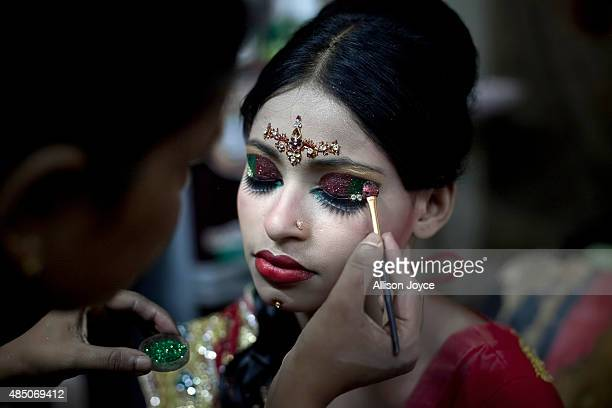 15 year old Nasoin Akhter has her makeup done at a beauty parlour on the day of her wedding to a 32 year old man August 20 2015 in Manikganj...