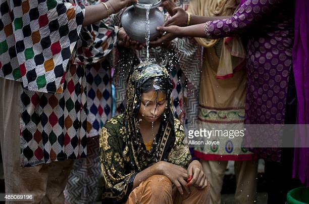 15 year old Nasoin Akhter is bathed on the day of her wedding to a 32 year old man August 20 2015 in Manikganj Bangladesh In June of this year Human...