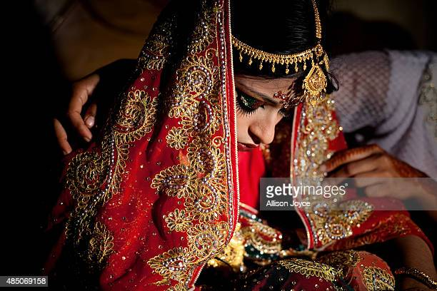 15 year old Nasoin Akhter is consoled by a friend on the day of her wedding to a 32 year old man August 20 2015 in Manikganj Bangladesh In June of...