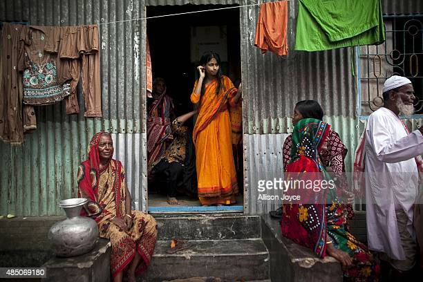 15 year old Nasoin Akhter stands in the doorway of a neighbors home on the day of her wedding to a 32 year old man August 20 2015 in Manikganj...