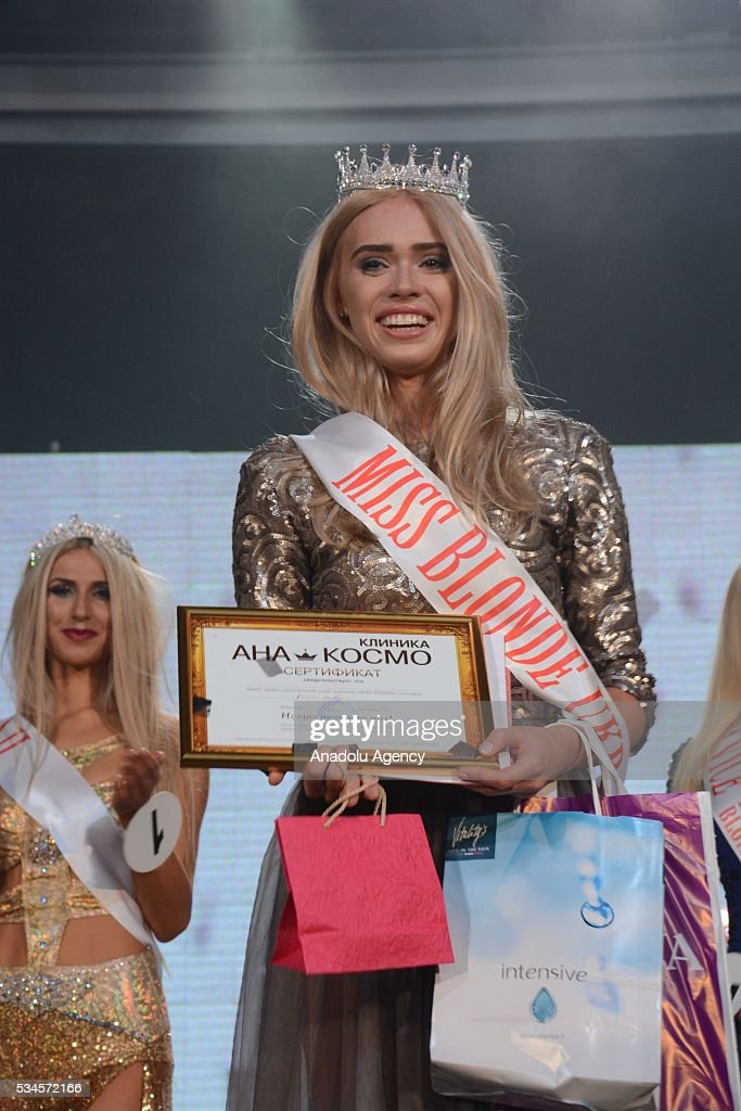 21 year old Natasha Spitkovskaya is seen after she received the title of the Miss Blonde 2016 during the 'Miss Blonde 2016' Beauty Contest in Kiev, Ukraine on May 26, 2016. Singers Iryna Bilyk, Nikolay Tishchenko, Boxer Vyacheslav Uzelkov and modeling agency owner Alexander Britain attended to a contest as a Juryman.