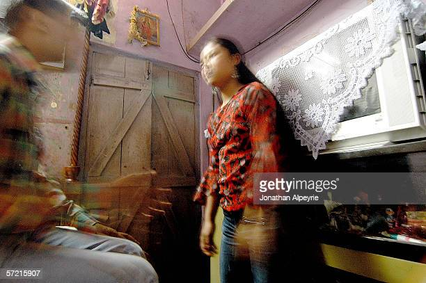 A 17 year old Nepali prostitute negotiates prices with a client November 11 2005 in Siliguri Utar Pradesh India