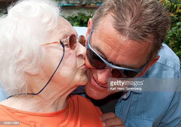 97 year old nursing home resident kissing her son-in-law