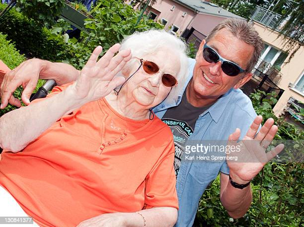 97 year old nursing home resident with her son-in-law, waving