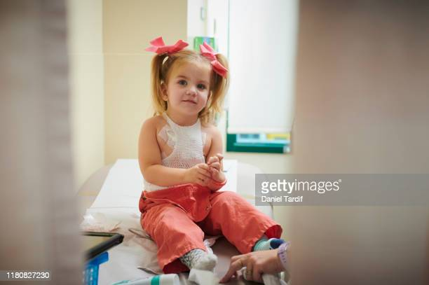 2 year old open heart surgery survivor getting check-up. - heart surgery scar stock photos and pictures