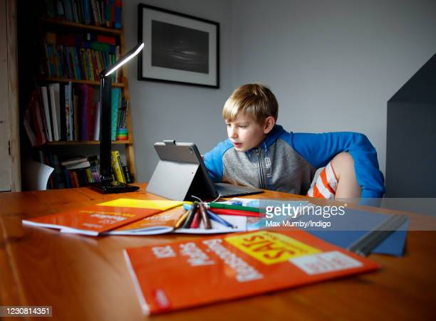 Year old Oscar Mumby completes his online schoolwork as homeschooling continues due to school closures on January 27, 2021 in Cuckfield, United...