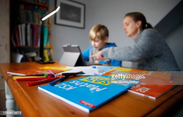 Year old Oscar Mumby is assisted with his online schoolwork by his mother Jo Mumby as homeschooling continues due to school closures on January 27,...