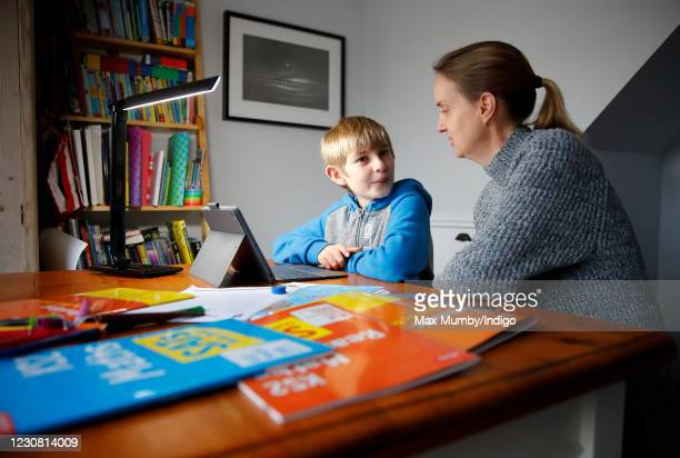 Year old Oscar Mumby, is assisted with his online schoolwork by his mother Jo Mumby as homeschooling continues due to school closures on January 27,...