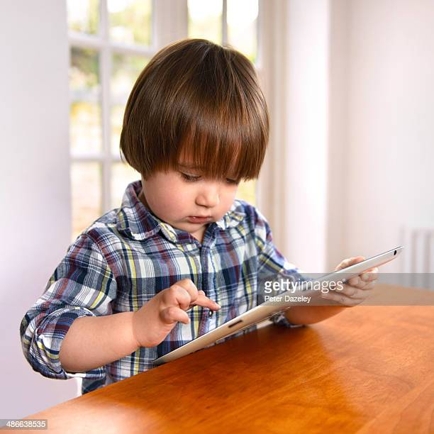 2 year old playing with tablet