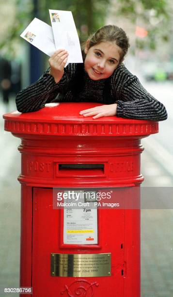 10 year old postman's daughter Laura Pendlebury officially reopens the post box damaged in the IRA bomb attack in Manchester city centre in 1996 The...