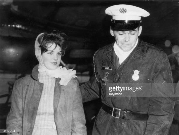 Year old Priscilla Beaulieu is led away by a military policeman whilst trying to say goodbye to her friend Elvis Presley at Frankfurt Airport, 2nd...